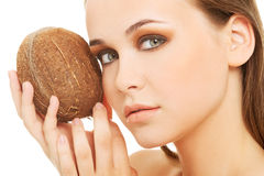 Attractive young woman with coconut. Closeup. Royalty Free Stock Photos