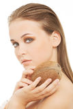 Attractive young woman with coconut. Closeup. Royalty Free Stock Images
