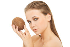Attractive young woman with coconut. Closeup. Royalty Free Stock Photo