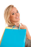 Attractive young woman with colorful shopping bags Royalty Free Stock Photos