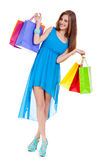 Attractive young woman with colorful shopping bags isolated Stock Photo