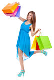 Attractive young woman with colorful shopping bags isolated Royalty Free Stock Photography