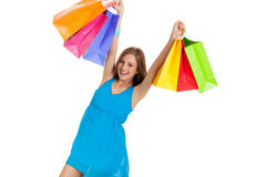 Attractive young woman with colorful shopping bags isolated Royalty Free Stock Images