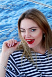 Attractive young woman coquettish eats cherry. dressed in a sail Royalty Free Stock Photos