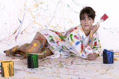 An attractive young woman covered in colorful paint Royalty Free Stock Photos