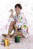 An attractive young woman covered in colorful paint Stock Photos