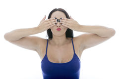 Attractive Young Woman Covering Her Eyes Pulling Faces Stock Photo