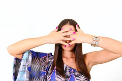 Attractive young woman covers her face her ​​hands isolated Royalty Free Stock Photos