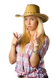 Attractive young woman in cowboy dress and hat. On white royalty free stock image