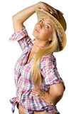 Attractive young woman in cowboy dress and hat. On white Stock Images