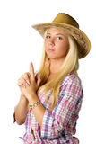 Attractive young woman in cowboy dress and hat. On white stock image