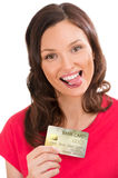 Attractive young woman with credit card Royalty Free Stock Image