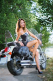 Attractive young woman on the cruiser motorcycle Royalty Free Stock Photography