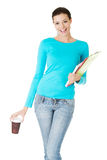 Attractive young woman with a cup and files. Stock Photography