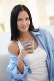Attractive young woman with cup in hand Royalty Free Stock Photography