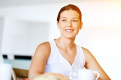 Happy young woman with cup of tea or coffee at home Stock Images