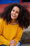 Attractive young woman with curly hair Royalty Free Stock Image
