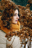 Attractive young woman with curly hair near dried hydrangea flow Stock Image
