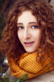 Attractive young woman with curly hair near pine tree Royalty Free Stock Photo