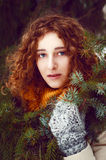 Attractive young woman with curly hair near pine tree Stock Image