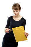 Attractive young woman cutting envelope Stock Photography