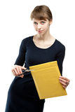 Attractive young woman cutting envelope Royalty Free Stock Images