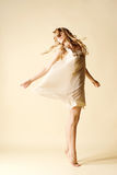 Attractive young woman dancing Royalty Free Stock Photos
