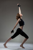 Attractive young woman dancing Stock Photography