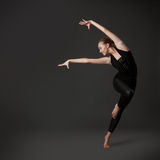 Attractive young woman dancing Royalty Free Stock Image