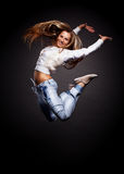 Attractive young woman dancing Royalty Free Stock Photography