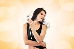 Attractive young woman dancing Stock Images
