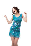 Attractive young woman dancing disco. Beautiful young female in short sparkling blue dress, clubbing, dancing disco with closed eyes bliss expression, isolated royalty free stock images