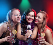 Attractive young woman dancing at disco and having fun Royalty Free Stock Images