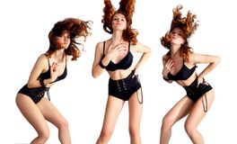Attractive young woman dancing, hair flying royalty free stock photography