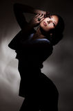 Attractive young woman in dark Stock Images