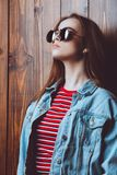 Woman in denim jacket Stock Image