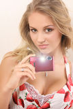 Attractive young woman with digital camera. Attractive young woman holding digital camera and looking at camera Stock Photography