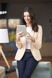 Attractive young woman with digital tablet Royalty Free Stock Photos