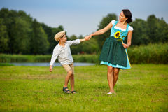 Attractive young woman in a dirndl with her son Royalty Free Stock Photography