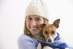 Attractive Young Woman and Dog Wearing Sweaters Royalty Free Stock Image