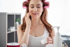 Attractive young woman doing beauty procedures at home royalty free stock photo