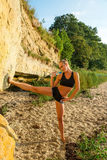 Attractive Young Woman Doing Exercise on the Beach Royalty Free Stock Photos