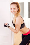 Attractive young woman doing fitness dumbbell Royalty Free Stock Image