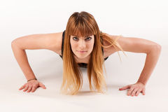 Attractive young woman doing pushups Royalty Free Stock Photo
