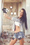 Attractive young woman doing with selfie old home camera Royalty Free Stock Image