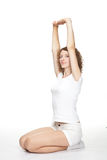 Attractive young woman doing sport exercises Stock Images