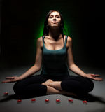 Attractive young woman doing yoga Royalty Free Stock Image