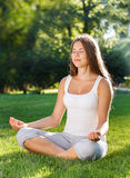Attractive young woman doing yoga Royalty Free Stock Photo