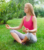Attractive young woman doing yoga Stock Images