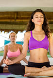 Attractive young woman doing yoga Stock Photos